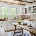 Kitchen, Wooden Floor, White Wall Tiles, White Upper Cabinet, White Pendant, Glass Window, Glass Ceiling Window, Wooden Bea,s, Wooden Table, Striped Rug, Wooden Counter Top