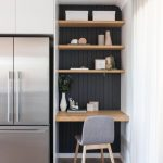 Kitchen, Wooden Floor, White Wall, White Cabinet, Silver Frige, Wooden Table, Wooden Shelves