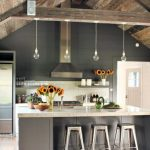 Kitchen, Wooden Vaulted Ceiling, Black Wall Planks, Bulb Pendants, Marble Counter Top, Grey Island, Wooden Floor