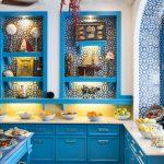 Kitchen, Yellow Patterned Floor, White Wall, Blue Patterned Tiles On The Wall, Blue Cabinet, White Counter Top, Yellow Backsplash