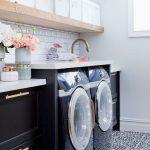 Laundry Room, Black Machines, Black Bottom Cabinet, Golden Handle, White Counter Top, White Wall, White Subway Backsplash, Patterned Floor