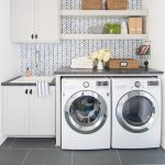 Laundry Room, Grey Floor, White Machine, White Floating Shelves, White Cabinet, White Sink, Grey Counter, Blue Line Patterned Accent