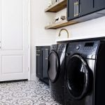 Laundry Room, Patterned Floor, White Wall, Black Upper Cabinet, Black Machines, Black Bottom Cabinet, Floating Wooden Shelves