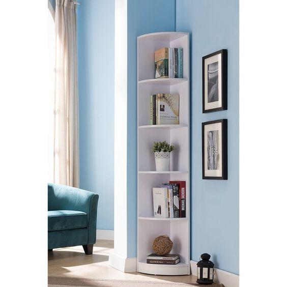 living room, brown floor, blue wall, white corner round shelves, blue sofa, white curtain