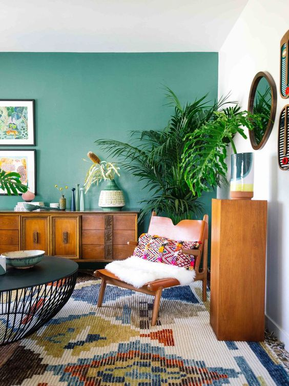 living room, colorful rug, white wall, green wall, wooden cabinet, black coffee table, wooden chair