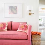 Living Room, White Wall, Brown Rug, Pink Sofa, Rattan Basket, White Sconce, White Framed Painting, White Wooden Beam