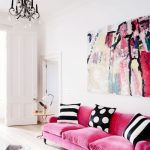 Living Room, White Wall, White Floor, Chandelier, White Ottoman For Coffee Table, Pink Sofa