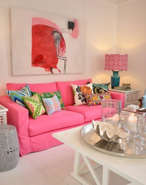 living room, white wooden floor, pink sofa, white wooden square coffee tbale, pink green table lamp, white side table