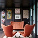 Living Room, Wooden Floor, Dark Wooden Wall, Orange Sofa, Orange Chairs, Rug