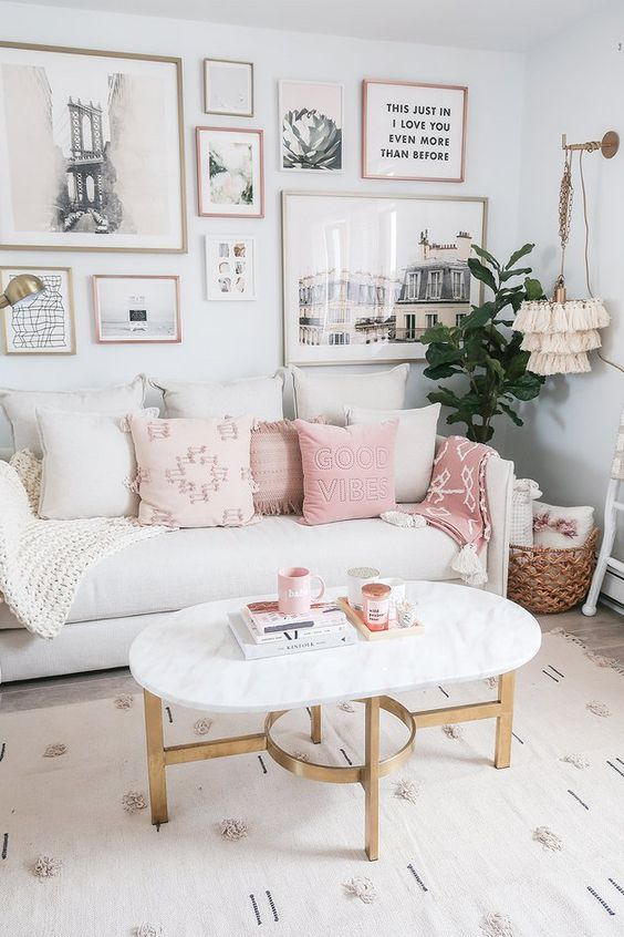 living room, wooden floor, white rug, white wall, white marble coffee table, whte sofa