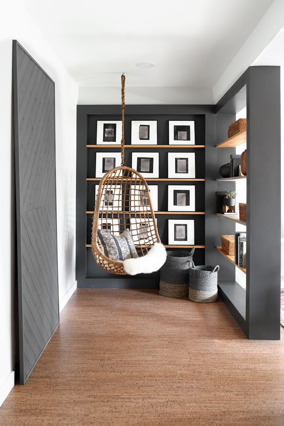 living room, wooden floor, white wall, grey accent wall, indented wall, floating shelves, grey partition