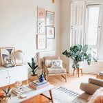Living Room, Wooden Floor, White Wall, Pink Chair, White Cabinet, White Wooden Coffee Table, Brown Sofa