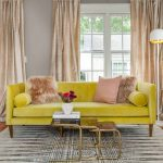 Living Room, Yellow Sofa, Wooden Floor, Patterned Rug, Golden Nesting Coffee Table, Brown Curtain