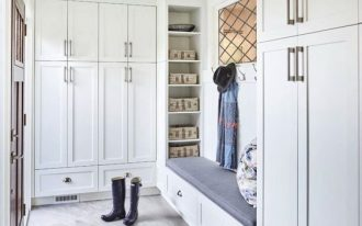 mudroom, grey marble floor, white wall, white cupboard, white drawers, grey cushion, white shelves