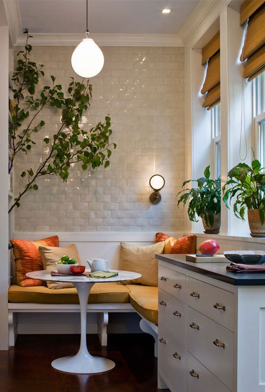 nook, dark wooden floor, white floating bench, yellow cushion, white wall, white bulb pendant, white cabinet