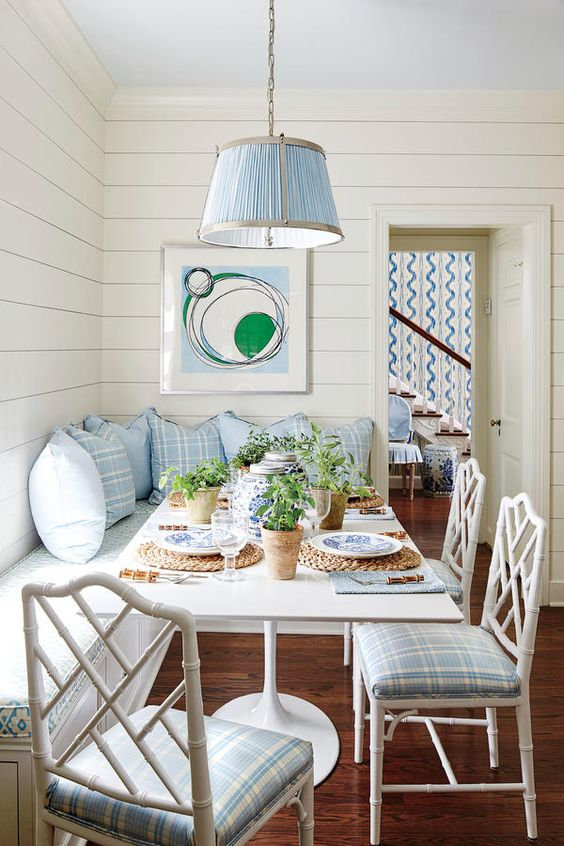 nook, dark wooden floor, white shiplap, white bench, white rectangular table, white chairs with blue cushion, blue bench cushion, blue pillow, blue pendant