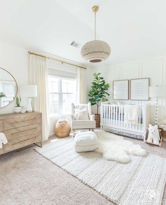 nursery, white rug, white rug floor, white wall, white crib, white chair, wooden cabinet, round mirror, white lamps