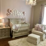 Nursery, Wooden Floor, Pink Wall, Cream Crib, Cream Chair, Cream Ottoman, Cream Cabinet, Crystal Ottoman, White Lamp