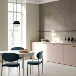 Open Kitchen, Grey Floor, Grey Wall, Light Pink Bottom Cabinet, Black White Pendant, White Round Table, Dark Teal Chairs