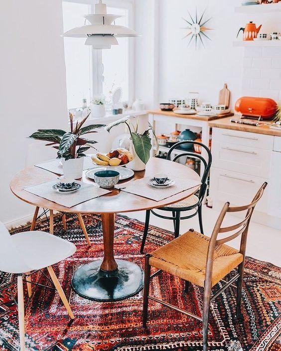 open kitchen, white floor, white bottom cabinet, white wall, white pendant, wooden round dining table, rattan seat, white midcentury modern, wooden counter top