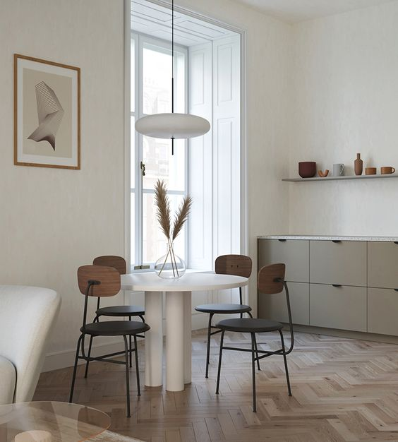 open kitchen, white wall, grey bottom cabinet, white pendant, white round table, brown chairs, open shelves, chevron floor