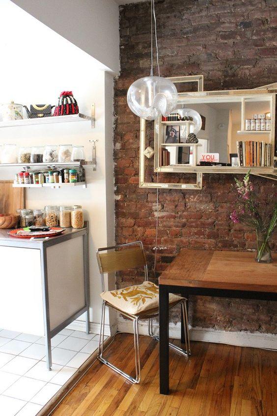 open kitchen, wooden floor, white square floor tiles, exposed wall, white cabinet, shelves, wooden table