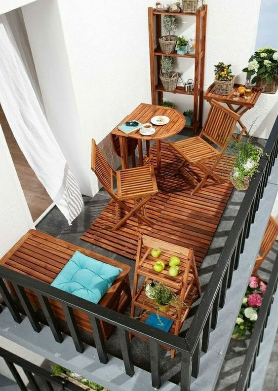 patio, grey floor, wooden grid in the floor, chairs, half round table, bench, shelves, side table