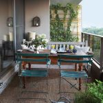 Patio, White Marble Floor, Rattan Rug, Wooden Table, Green Metal Chairs, White Wall, Glass Fence