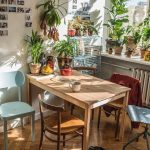 Patio, Wooden Herringbone Floor, Wooden Table, White Wall, Wooden Chairs, Metal Chairs, Plants,