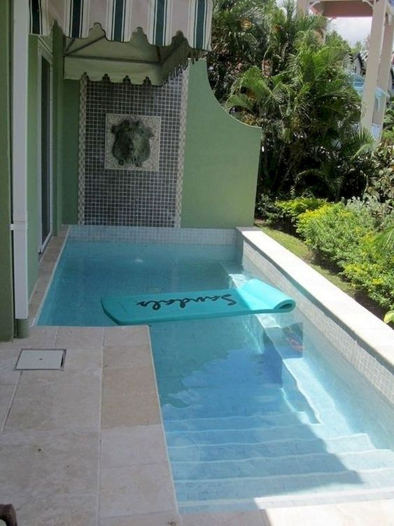 pool, brown marble, green wall, low wall