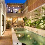 Pool, Cream Matble, Brown Floor, Stone Wall, Plants Along The Wall