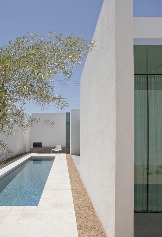 pool, vream marble floor, cream wall, plant, white chair, rectangular pool