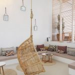 Rattan Swing, White Chevron Floor, White Wall, Bench Along The Wall, Brown Cushion, White Round Coffee Table