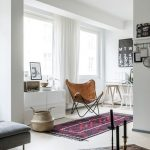 Reading Corner, White Floor, White Wall, White Cabinet, Brown Leather Chair, White Table, White Chair, Purple Rug
