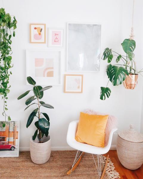 reading corner, wooden floor, white wall, white midcentury modern rocking chair, rattan rug, rattan basket
