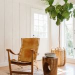 Reading Corner, Wooden Floor, White Wooden Planks, White Ceiling, Wooden Chairs, Leather Seating, Wooden Stool, Plants In Rattan Pot