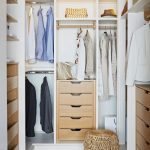 Small Closet, Brown Rug, White Nook With Rod, Brown Wooden Drawers
