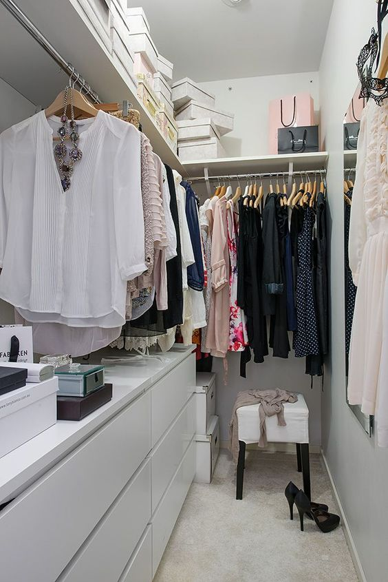 small closet, cream floor, light grey cabinet, rod, shelves