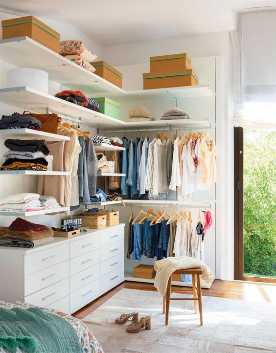 small closet, wooden floor, white shelves, white cabinet, rod