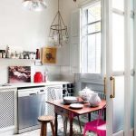 Small Kitchen, Pattern Floor Tiles, White Wall, White Cabinet With White Counter Top, Silver Pendant, Wooden Table, Different Chairs