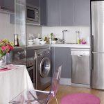 Small Kitchen, Wooden Floor, Grey Cabinet, White Backsplash, Silver Fridge, Acrylic Chair, Pink Mat