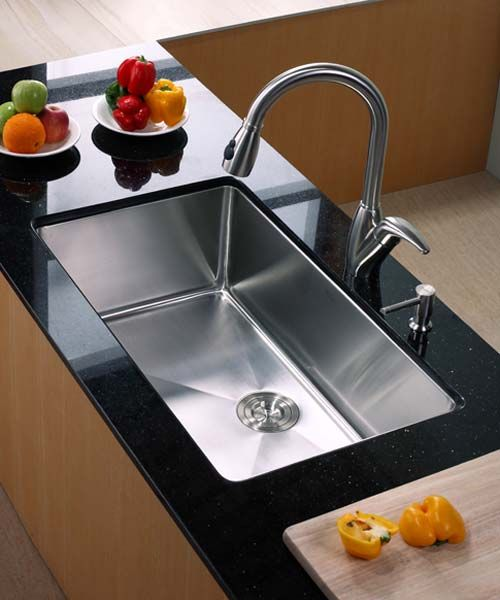 stainless undermount sink, black marble counter top, wooden counter, stainless faucet