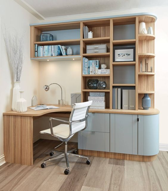 study, wooden built in shelves and table, blue cabinet door, wooden floor, white wall