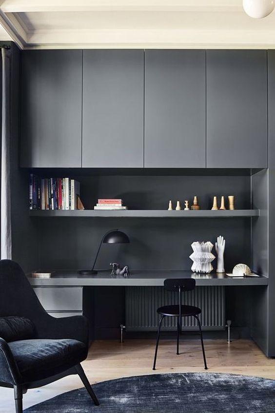 study, wooden floor, black cabinet, black table, black chair, black table lamp, black round rug, black velvet chair