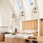 Vaulted Ceiling, Glass Ceiling Windows, Interesting Pendants With Metal, White Wall, Wooden Counter, Wooden Cabinet, Wooden Island With White Top
