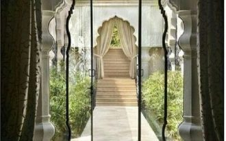 white curvy arch, glass doors, white column, marble floor