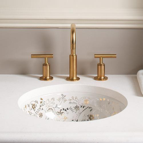 white sink, undermounted, golden details inside, golden faucet
