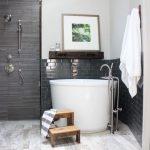 White Soaking Tub, White Marble Floor Tiles, White Wall, Black Subway Tiles, Black Tiles, Dark Floating Shelves