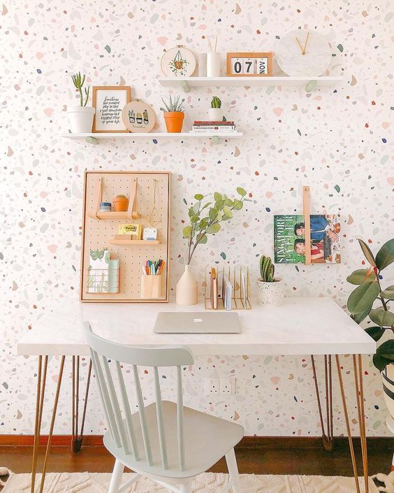 white terrazzo marble on the wall, white study table, white wooden chair, white floating shelves, white rug