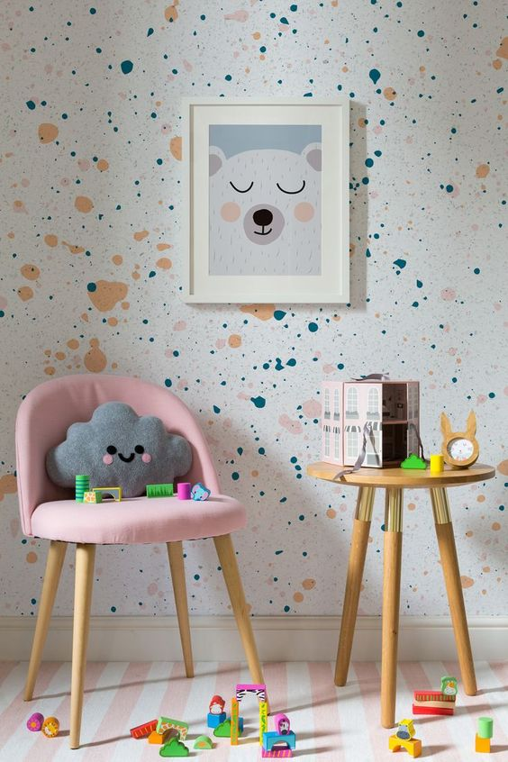white terrazzo wall, pink white stripe floor, pink chair, wooden round stool